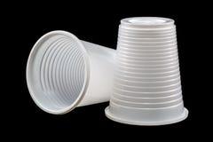 2 чашки на черноте Стоковое Изображение