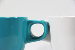 2 чашки ручки креста Стоковое Изображение