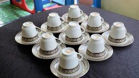 Чашки чая на плите Стоковые Изображения