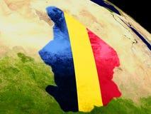 Чад с флагом на земле Стоковая Фотография