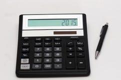 Чалькулятор и ручка стоковая фотография rf