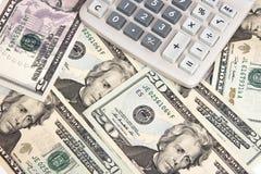 Чалькулятор на 20 счетах доллара Стоковая Фотография
