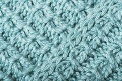 Чеканьте связанный крупный план текстуры ткани Смогите быть использовано как предпосылка Селективный фокус стоковые фото