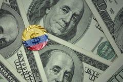 чеканьте с знаком доллара с национальным флагом Колумбии на предпосылке банкнот денег доллара Стоковая Фотография