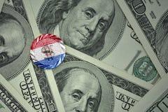 чеканьте с знаком доллара с национальным флагом Парагвая на предпосылке банкнот денег доллара Стоковое фото RF