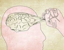 Человек вытягивает вне мозг Стоковое Изображение