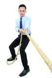 Человек вытягивая веревочку стоковые изображения rf