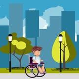 Человек в кресло-коляске в парке Стоковое Фото