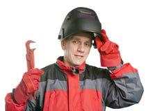 Человек в одеждах деятельности и маска сварщика с гаечным ключом стоковые изображения rf