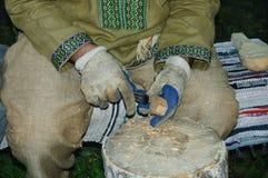 Человек в русском национальном костюме стоковые изображения