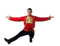 Человек в русском costume выполняя танцульку Стоковая Фотография