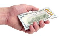 Человек дает или принимает кучу счетов 100-доллара Тысяча долларов в руке на белой предпосылке изолировано Конец-вверх Стоковое Изображение RF
