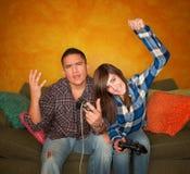 человек девушки игры испанский играя видео Стоковое Изображение