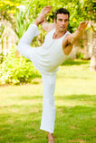 Человек делая йогу Стоковая Фотография RF