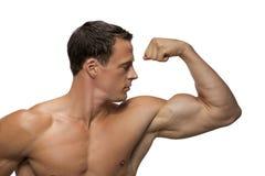 Человек делая мышцу стоковые изображения