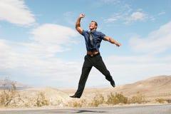 человек дела воздуха восторженный скача Стоковое фото RF