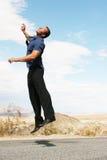 человек дела воздуха счастливый скача Стоковые Фото