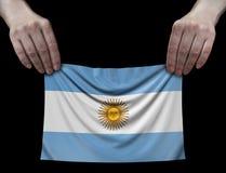 Человек держа флаг Аргентины Стоковая Фотография RF