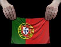 Человек держа флаг португалки Стоковое фото RF