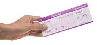 Человек держит билет для самолета белизна изолированная предпосылкой стоковые фотографии rf