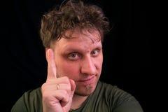 Человек держит его указательный палец вверх Идея bipeds стоковые изображения