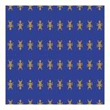 Человек золота племенной на голубой предпосылке стоковое фото rf