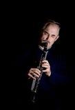 Человек играя джаз кларнета Стоковая Фотография