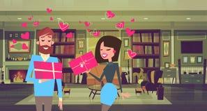 Человек и женщина держа подарочные коробки над парами форм сердца с настоящими моментами дня валентинок иллюстрация штока