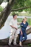 Человек и женщина около озера. Ссора. Стоковое фото RF