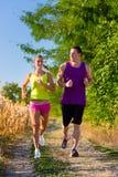 Человек и женщина работая для спорта Стоковая Фотография