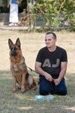 Человек и собака Стоковое фото RF