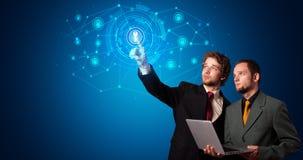 Человек касаясь символу безопасностью hologram стоковое фото rf