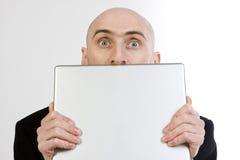 человек компьтер-книжки удерживания Стоковые Фото