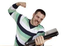 человек компьтер-книжки фрустрации компьютера Стоковое фото RF