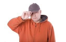 человек крышки около фуфайки крыши ладони Стоковое Фото