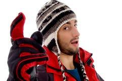 человек куртки крышки указывая нося зима Стоковое Изображение