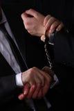 человек надеванный наручники делом Стоковая Фотография
