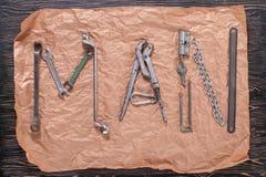 ЧЕЛОВЕК надписи написан инструментами работы Слово ЧЕЛОВЕК составлено инструментов работы Стоковое фото RF