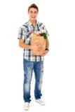 человек нося бакалеи мешка Стоковая Фотография RF