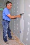человек отделкой drywall Стоковые Фотографии RF