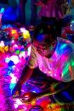 Человек продавая игрушки света стоковое фото rf