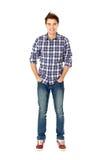 человек стоя молод стоковое фото rf