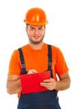 Человек строителя пишет к clipboard Стоковое Изображение RF