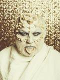 Человек с кожей дракона стоковая фотография rf