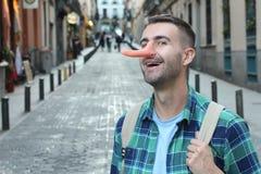 Человек с очень длинным носом стоковое изображение rf