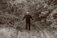 Человек с тыквой на его голове Сказание хеллоуина стоковое изображение