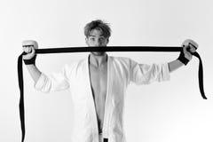 Человек с удивленной стороной и щетинка на белой предпосылке Стоковая Фотография