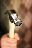 человек удерживания молотка Стоковые Фото
