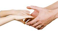 человек удерживания руки ребенка Стоковые Изображения