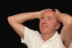 человек удерживания рук головной унылый Стоковые Фотографии RF